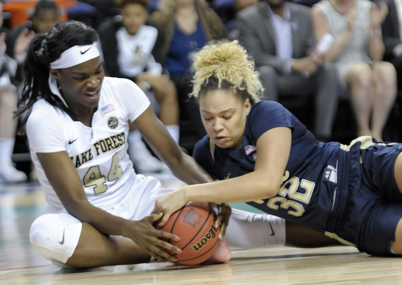 Junior Kalista Walters (32) fights for a loose ball against Wake Forest's Ona Udoh (44) in Pitt's 72-38 loss to Wake Forest Wednesday night. (Photo courtesy of Pitt Athletics)