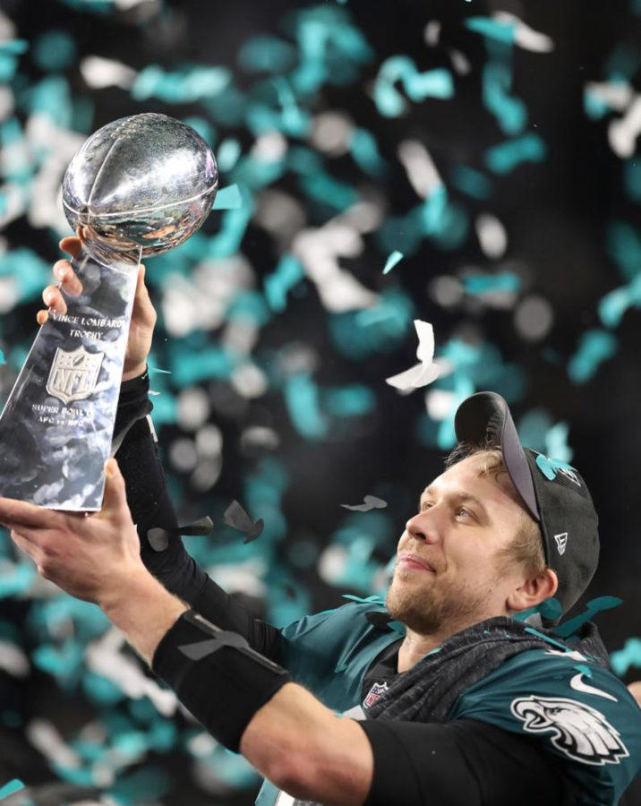Philadelphia Eagles quarterback Nick Foles lifts up the Vince Lombardi trophy after leading his team to a 41-33 victory over the New England Patriots in the 2018 Super Bowl on Sunday. (Jerry Holt/Minneapolis Star Tribune/TNS)