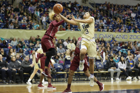 Sophomore guard Jasmine Whitney (3) attempts a layup during Pitt's 66-59 loss to Florida State Sunday afternoon. (Photo by Anas Dighriri | Staff Photographer)