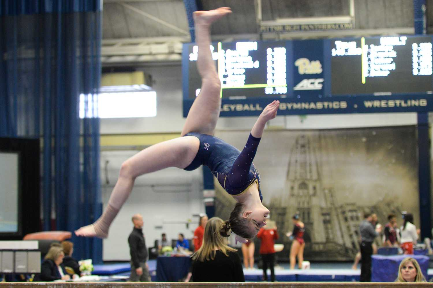 Sophomore Lucy Jones completes a back aerial while competing on beam during Saturday's quad meet at Pitt. (Photo by John Hamilton | Managing Editor)