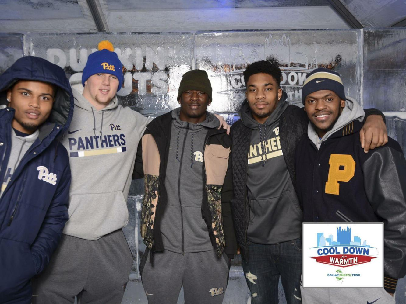 Shocky Jacques-Louis (middle) stands alongside fellow Pitt football recruits and Celeste Welsh, the Pitt Athletics media relations coordinator, at the Cool  Down for Warmth fundraiser Jan. 25. (Photo courtesy of Jake Kradel)
