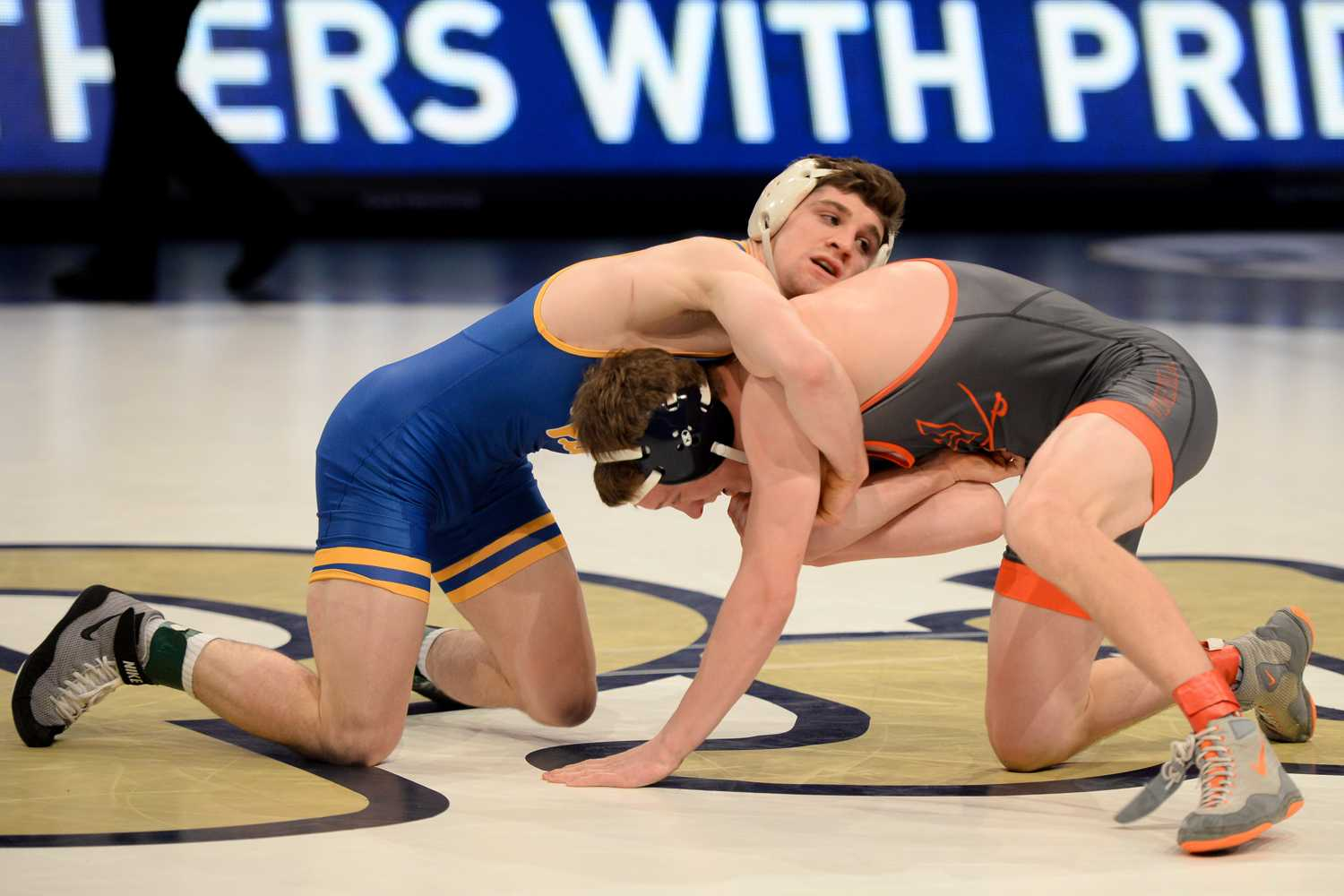 Senior Dom Forys grapples with his opponent during Pitt's 28-9 victory over Virginia Friday night. (Photo by Chiara Rigaud | Staff Photographer)