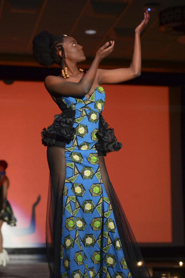 Oyinye Ikwuegbo, a senior at Pitt, strikes a pose in a dress made by one of the five designers who contributed designs to the Wazobia Fashion Show.  (Photo by Chiara Rigaud | Staff Photographer)