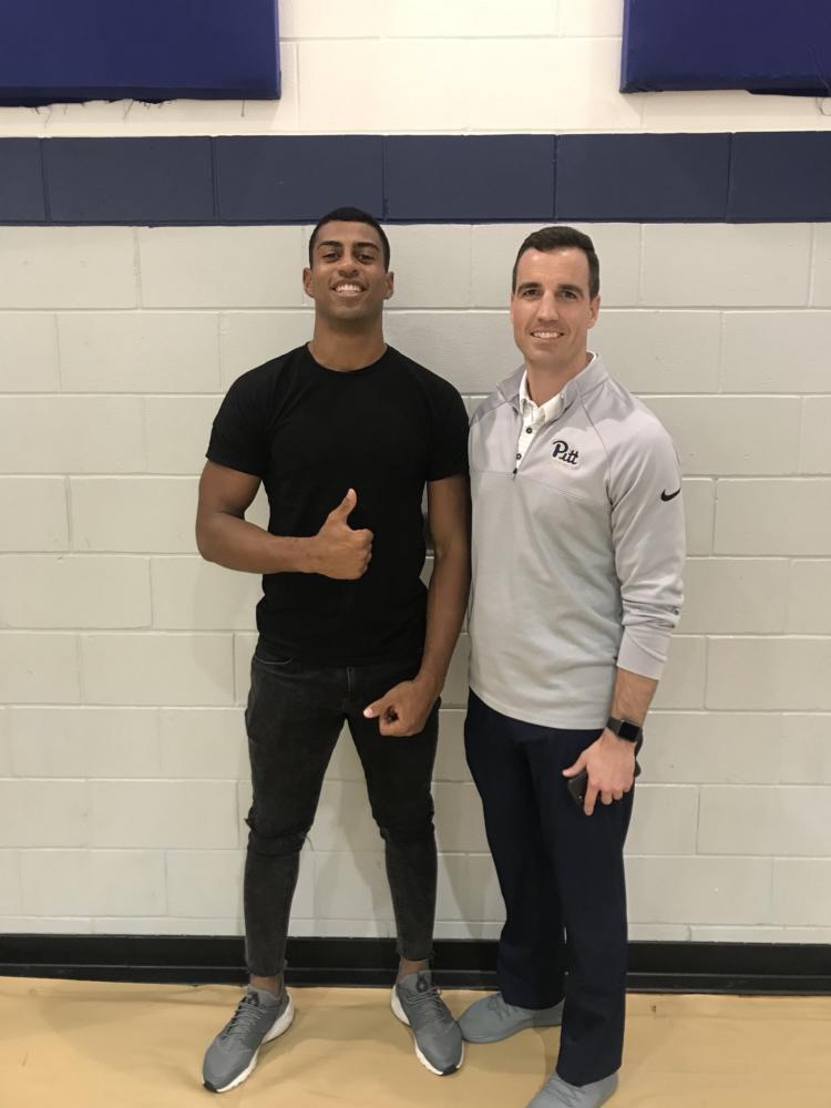 Pitt defensive line recruit Habakkuk Baldonado with Pitt linebacker coach Rob Harley.