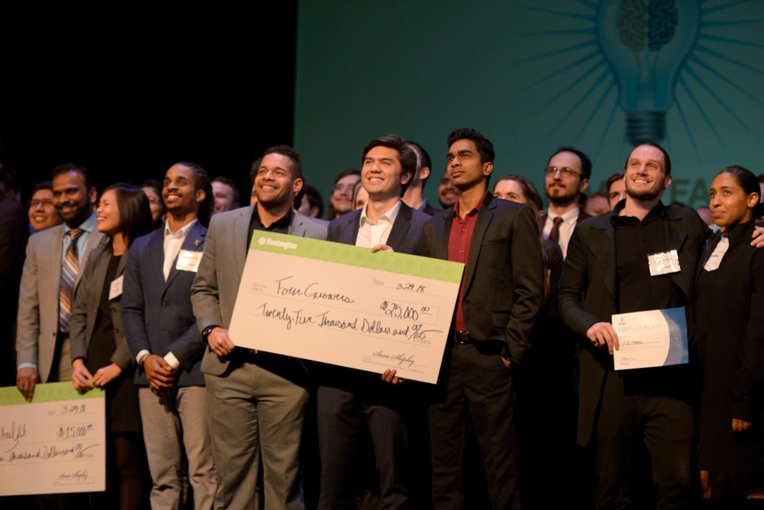 (From left) Daniel Garcia, Brandon Contino and Rahul Ramakrishnan of Four Growers accept first place at the Randall Family Big Idea Competition Celebration event Thursday afternoon. (Photo by Divyanka Bhatia | Staff Photographer)