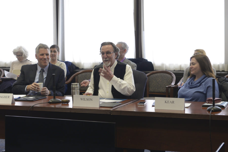 Chancellor Patrick Gallagher (left), University Senate Council president Frank Wilson and liaison librarian Robin Kear (right) attend the monthly University Senate Council meeting in Posvar Hall Wednesday. (Photo by  Chiara Rigaud | Staff Photographer)