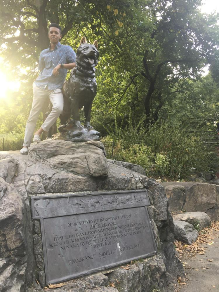 Christopher Dayer poses with the Balto statue, a sculpture of a historical sled dog, in New York City's Central Park. (Photo Courtesy of Amanda Nichols)