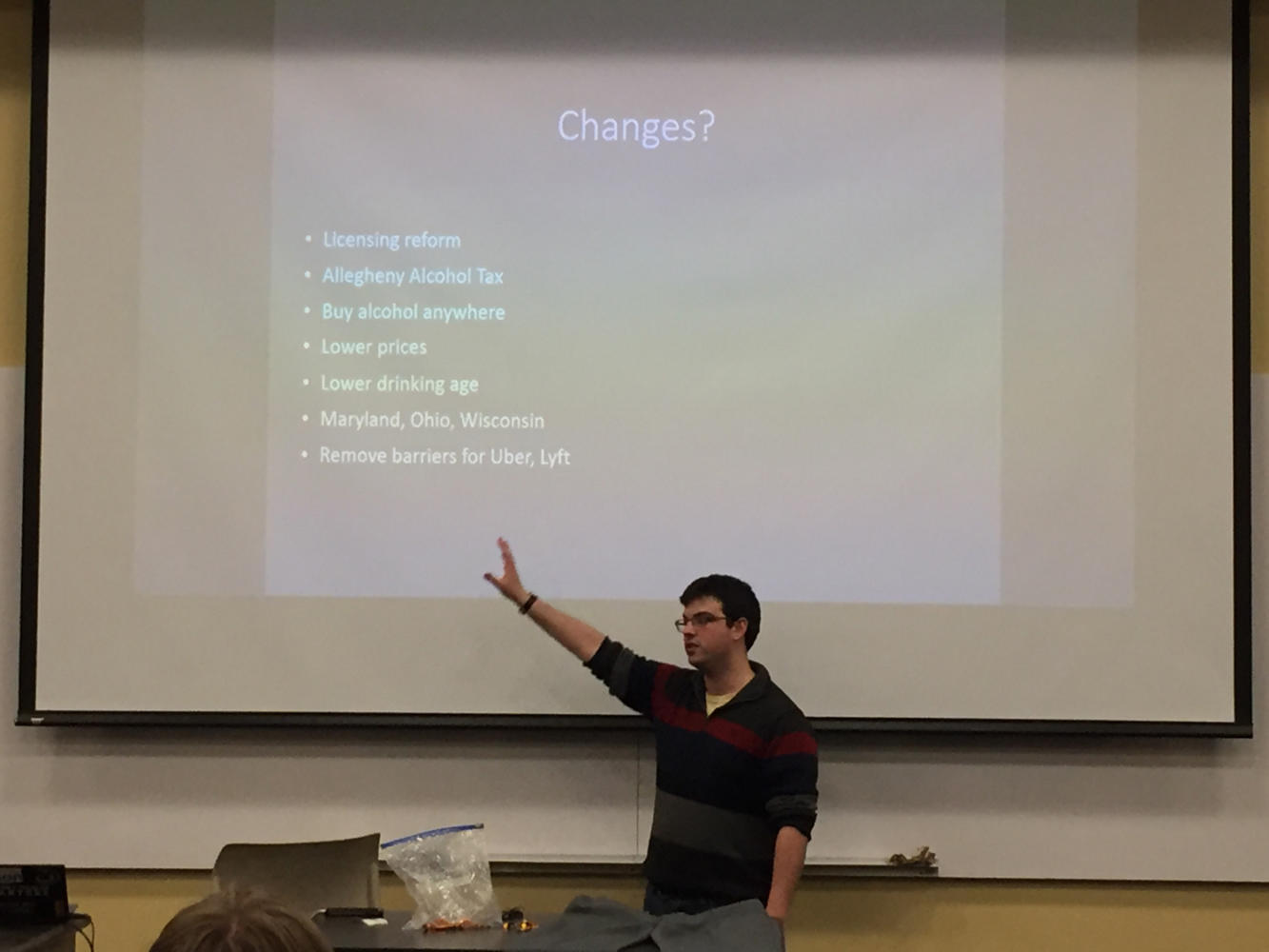 Pitt's Students for Liberty club president Ben Sheppard delivers a presentation featuring potential changes that could be made to Pennsylvania's liquor laws. (Photo by Neena Hagen | Staff Columnist)