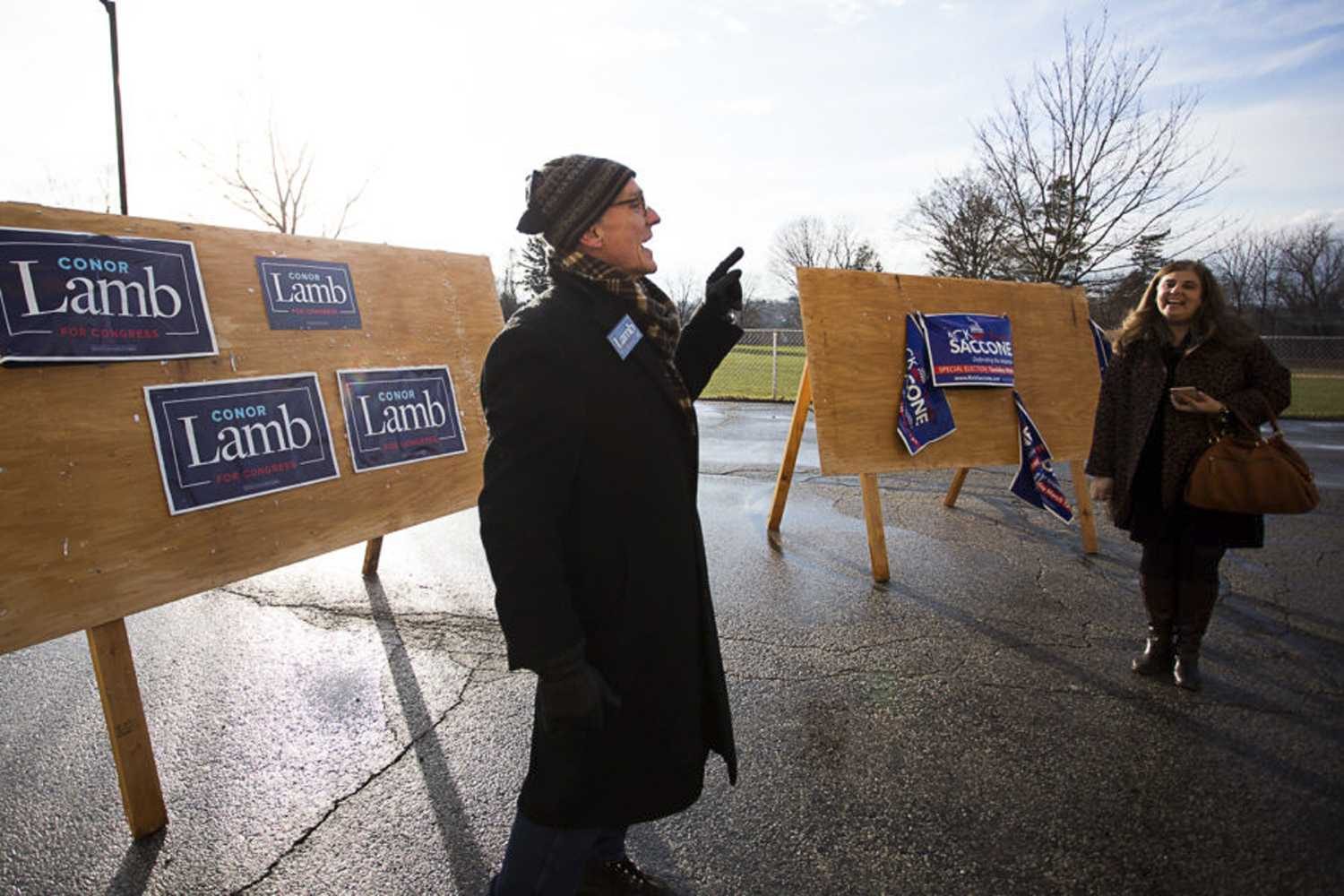 Supporters campaign for Democrat candidate Conor Lamb and Republican candidate Rick Saccone. Libertarian Party candidate Drew Miller went largely unnoticed during Tuesday's special election. (Photo by John Hamilton | Managing Editor)