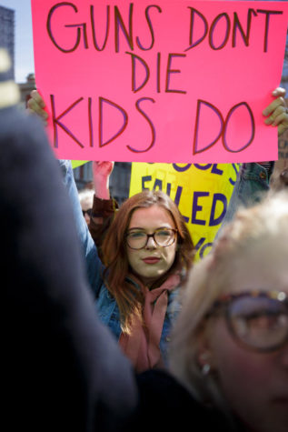 A demonstrator participates in the March For Our Lives rally, in which protesters demanded stricter gun control laws Saturday morning. (Photo by Thomas Yang | Visual Editor)