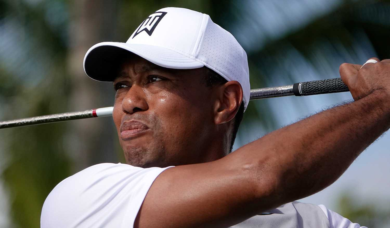 Tiger Woods watches a tee shot fly Feb. 21, 2018, during the Pro-Am round of the Honda Classic at the PGA National in Palm Beach Gardens, Florida. (Joe Cavaretta/Sun Sentinel/TNS)