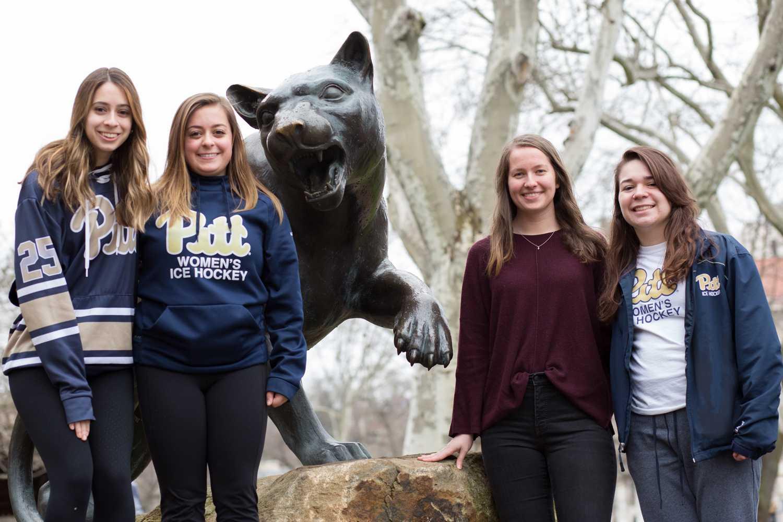 Pitt Women's Club Hockey members Dana Julian, Shannon McCafferty, Rose Saleh and Bre Doherty (from left). (Photo by Thomas Yang | Visual Editor)