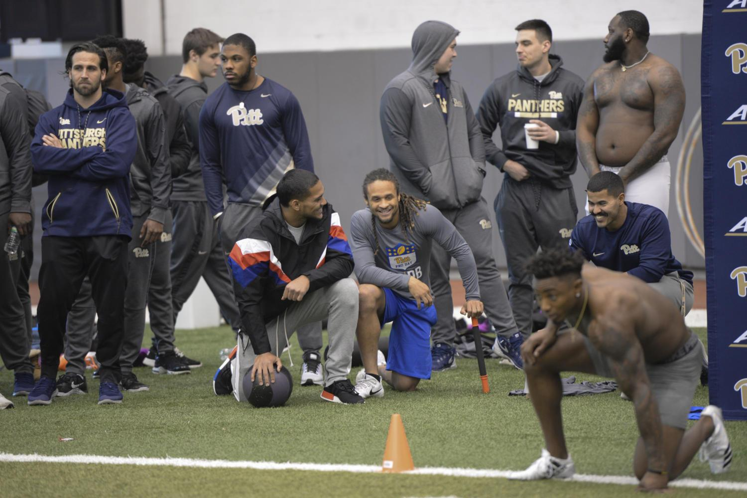 The Pitt football team casually stands around and spectates teammates undergoing various tests in the UPMC Rooney Sports Complex. (Photo by Mackenzie Rodrigues | Contributing Editor)