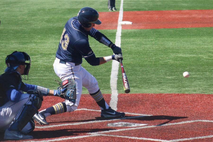 Junior catcher Cole Maclaren (43) puts the ball in play at Sunday afternoon's 6-5 loss to Duke. (Photo by Chiara Rigaud | Staff Photographer)