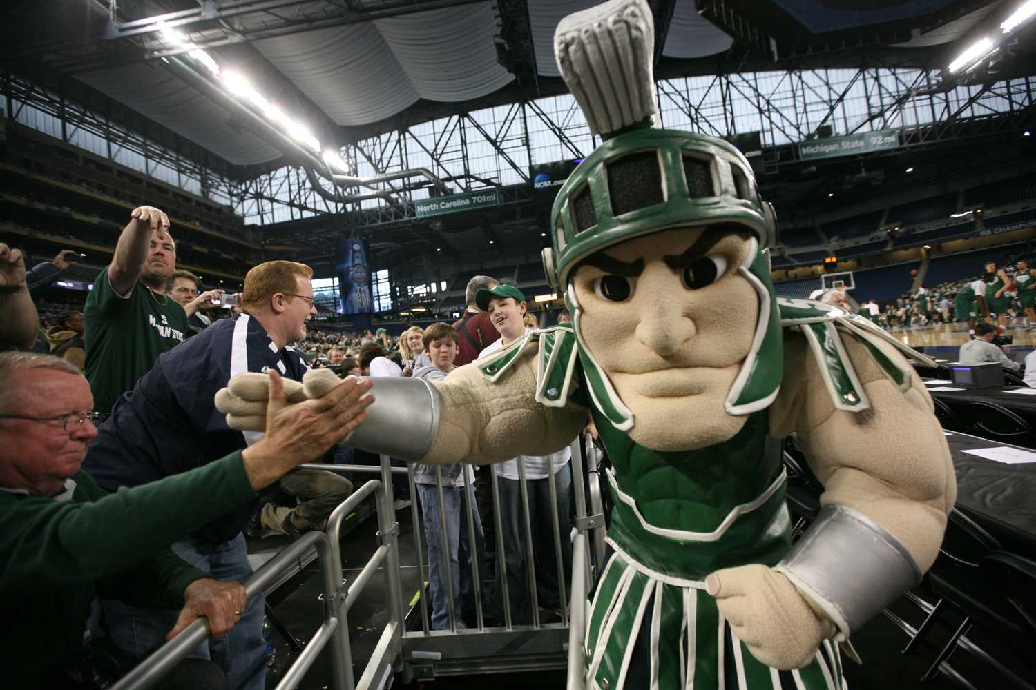 Michigan State mascot Sparty high fives fans as they wait for the players to come onto the court for practice for the Final Four at Ford Field in Detroit in 2009. (Andre J. Jackson/Detroit Free Press/MCT)