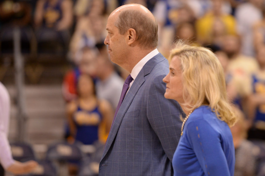 Former men's basketball head coach Kevin Stallings stands beside athletics director Heather Lyke at his last home game against Virginia. (Photo by John Hamilton | Managing Editor)