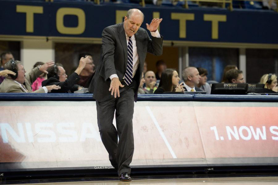 Former men's basketball head coach Kevin Stallings gestures from the sidelines at Pitt's 59-45 loss to Syracuse Nov. 16, 2017. (Photo by Anna Bongardino | Senior Staff Photographer)