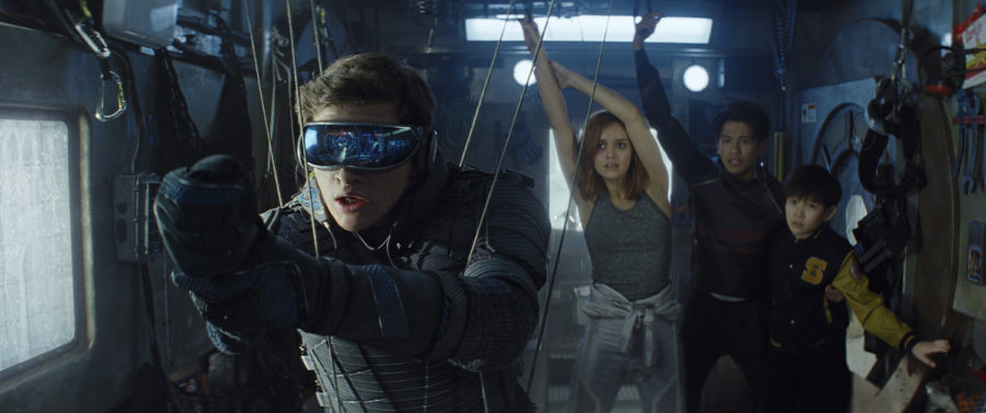 "From left, Tye Sheridan as Wade Watts, Olivia Cooke as Samantha Cook, Win Morisaki as Daito and Philip Zhao as Sho in ""Ready Player One."" (Warner Bros. Pictures/TNS)"