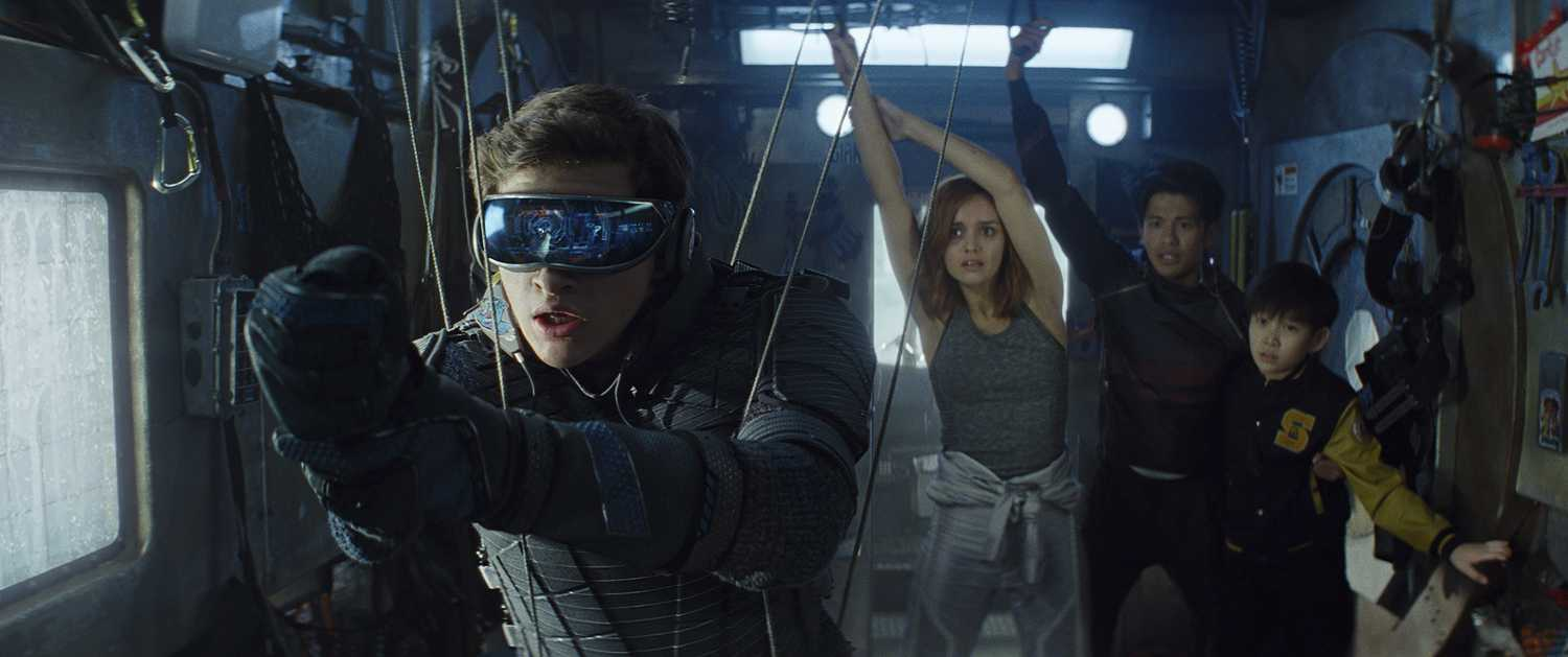 """From left, Tye Sheridan as Wade Watts, Olivia Cooke as Samantha Cook, Win Morisaki as Daito and Philip Zhao as Sho in """"Ready Player One."""" (Warner Bros. Pictures/TNS)"""