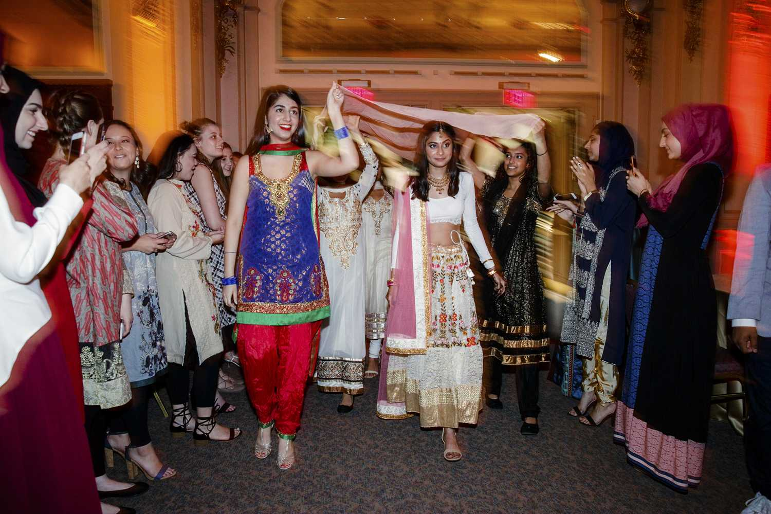 Friends hold a sheer tapestry over the head of Kamya Menon, the bride in the Pitt Pakistani Student Association's Mock Shaadi event. (Photo courtesy of Jorge Santiago)