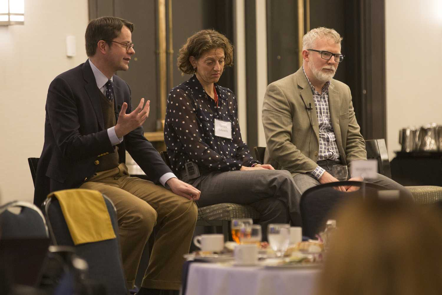 """From left to right, Tyler Vanderweele of Harvard University, Tamara Dubowitz of the RAND Corporation and Jeffrey Bishop of Saint Louis University discuss the health policy community and its ability to evaluate factors such as spirituality, friendship and happiness at the Can Science Measure the """"Culture of Health""""? event in the William Pitt Union Monday night. (Photo by Anas Dighriri 