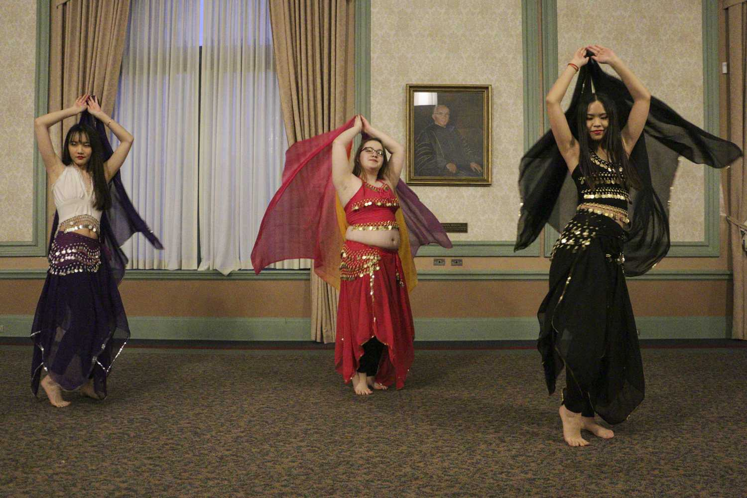 Xinyu Li (left), a senior majoring in microbiology, Victoria Wright, a junior majoring in ecology and evolution, and Ying-Tung Chou (right), a junior majoring in applied developmental psychology, represent Panther Belly Dancers and perform a traditional belly dance at the A Night in Beirut event in the William Pitt Union Monday night. (Photo by Isabelle Glatts | Assistant Visual Editor)