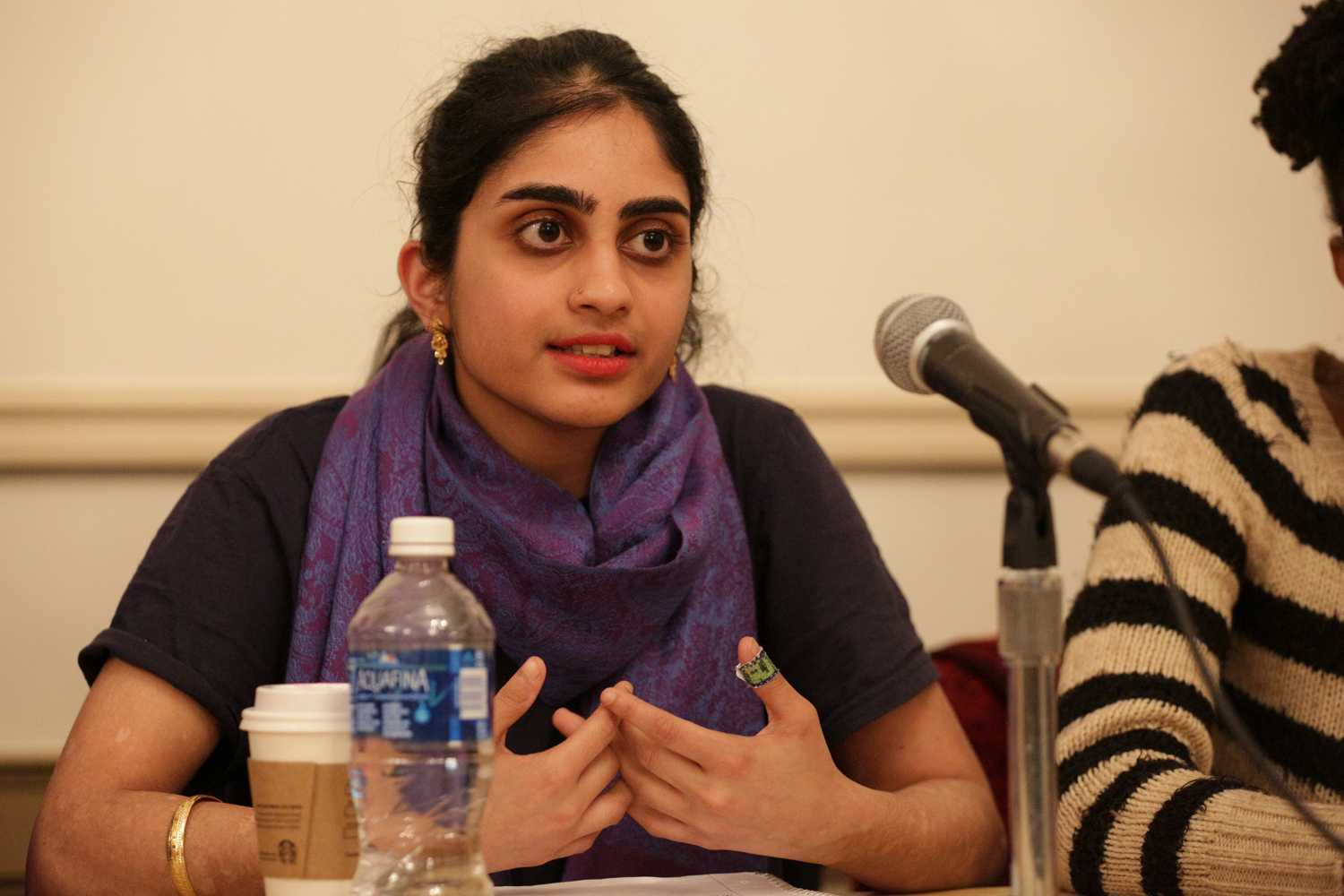 Krithika Pennathur, founder of Pitt Unmuted, speaks about sexual assault in marginalized communities at Monday night's Intersectionality of Sexual Violence: How the Issue Impacts Marginalized Populations panel. (Photo by Thomas Yang | Visual Editor)