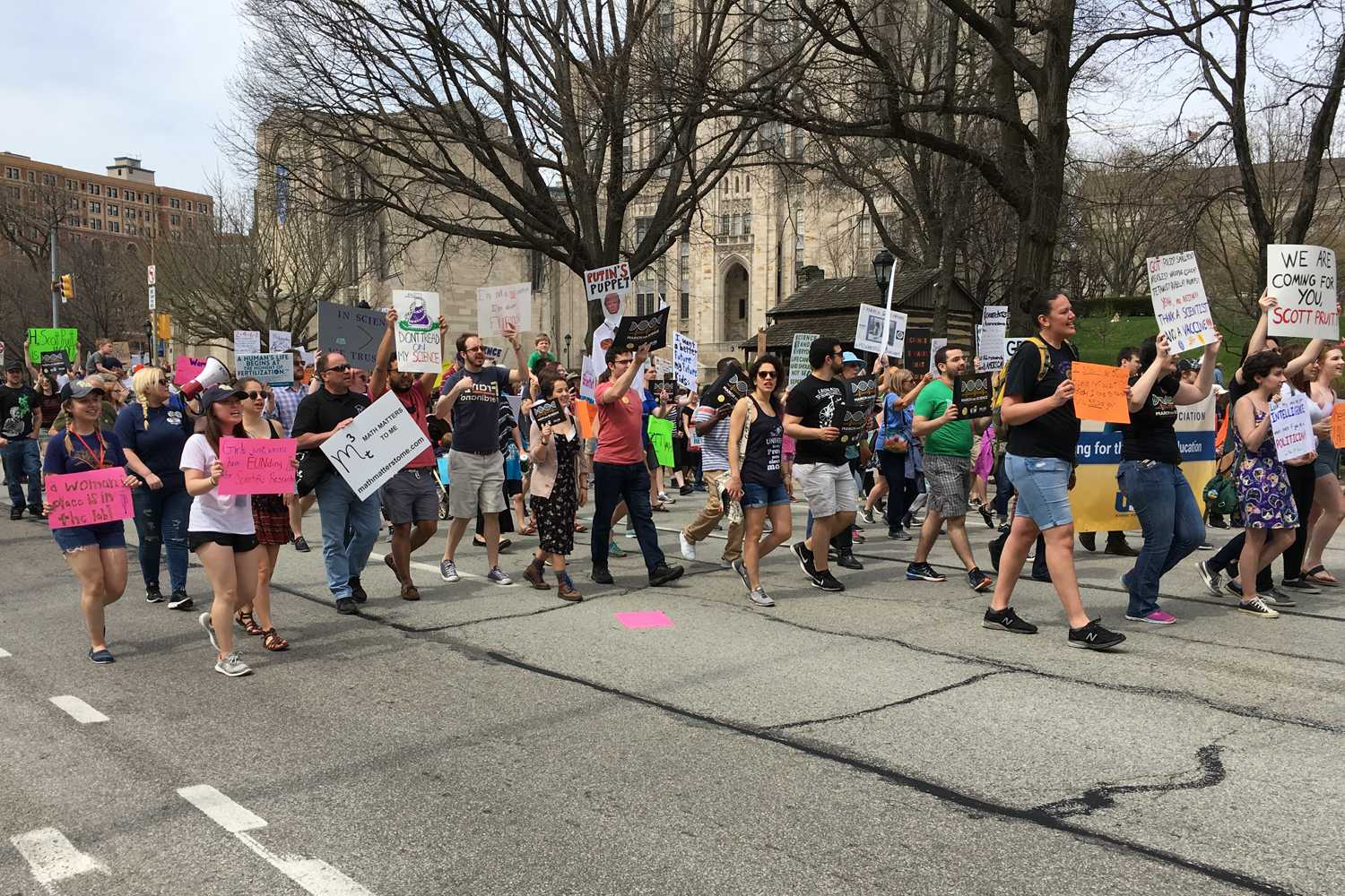 Protesters march down Forbes Avenue during Saturday's March for Science. (Photo by Kenan Meral | Staff Writer)