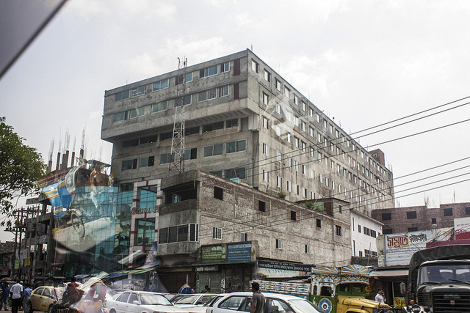 The Rana Plaza building was a five-story garment factory that collapsed in April 2013 after the building's owners ignored warnings to avoid using the building the day before. (Photo via Wikimedia Commons)