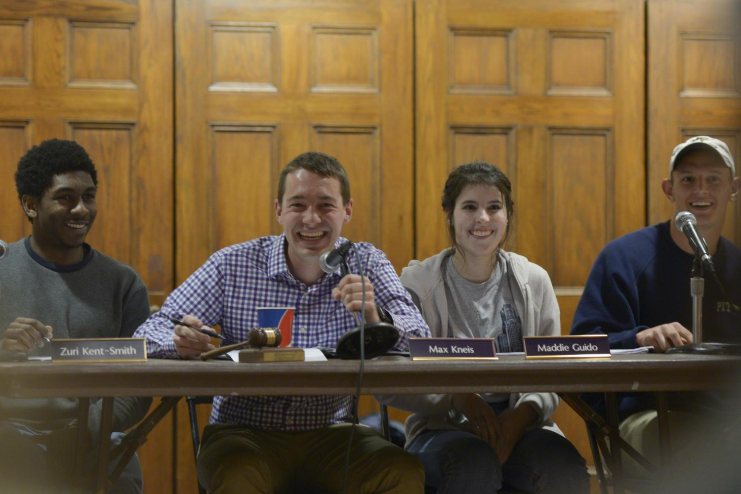 Board members laugh at Tuesday's SGB meeting. (Photo by Sarah Cutshall / Visual Editor)