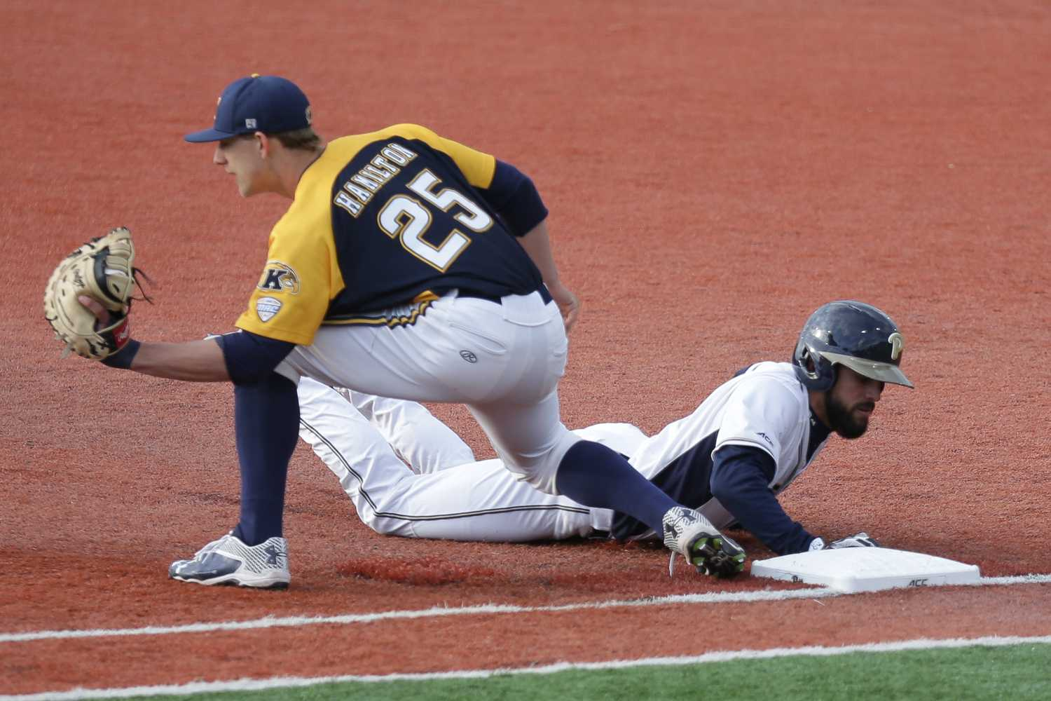 Redshirt senior Frank Maldonado slides into first base after attempting to steal second at Pitt's 4-1 loss to Kent State Tuesday evening. (Photo by Thomas Yang | Visual Editor)