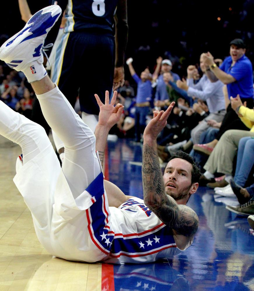 The Philadelphia 76ers' J.J. Redick celebrates after getting fouled on a 3-pointer by the Memphis Grizzlies in the second quarter of a preseason game at Wells Fargo Center in Philadelphia on Oct. 4, 2017. (Charles Fox/Philadelphia Inquirer/TNS)