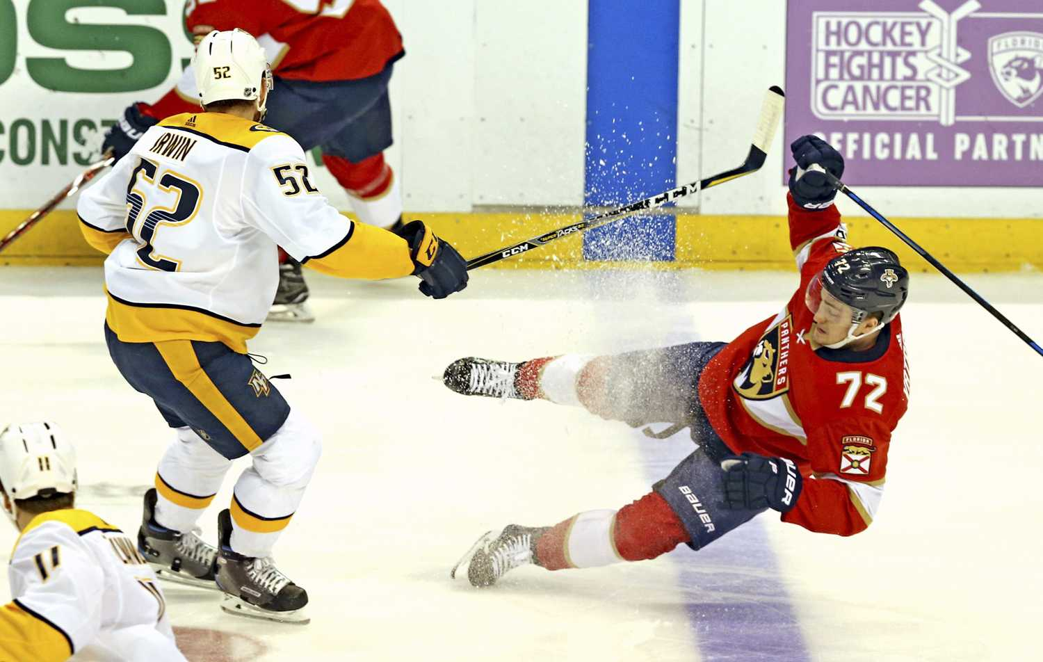 The Florida Panthers' Frank Vatrano (72) is knocked to the ice by the Nashville Predators' Matt Irwin (52) in the first period on Tuesday, April 3. (Charles Trainor Jr./Miami Herald/TNS)