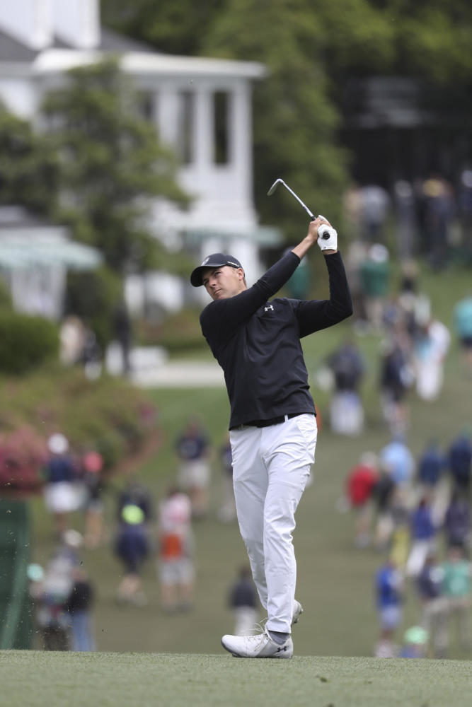 Jordan Spieth hits his fairway shot on one during the final round of the Masters at Augusta National Golf Club on Sunday. (Curtis Compton/Atlanta Journal-Constitution/TNS)