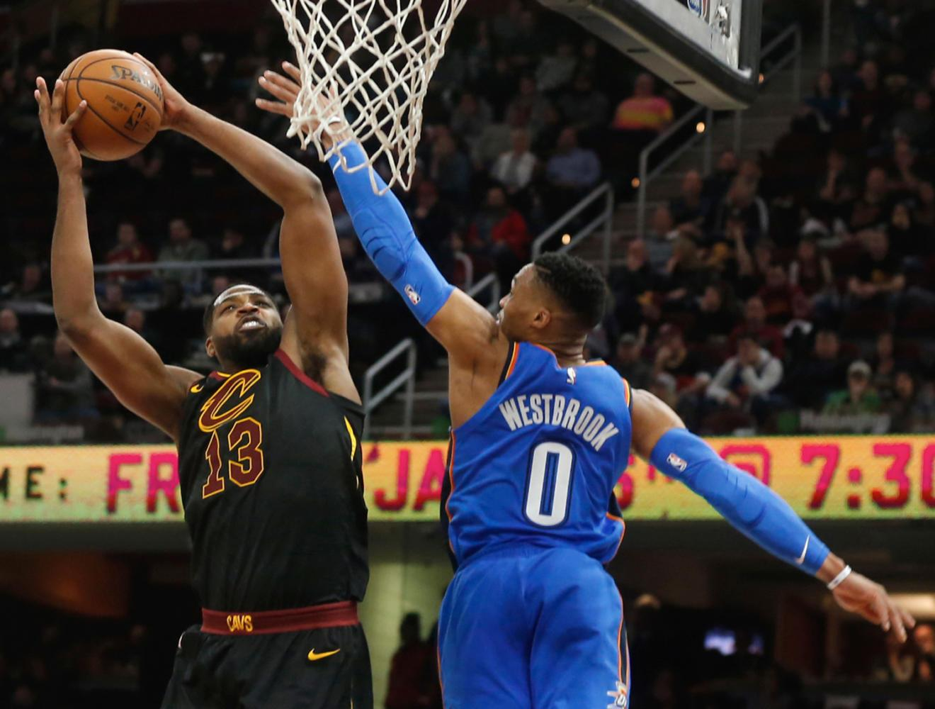 The Cleveland Cavaliers' Tristan Thompson, left, scores against the Oklahoma City Thunder's Russell Westbrook in the fourth quarter Jan. 20 at Quicken Loans Arena in Cleveland. (Leah Klafczynski/Akron Beacon Journal/TNS)