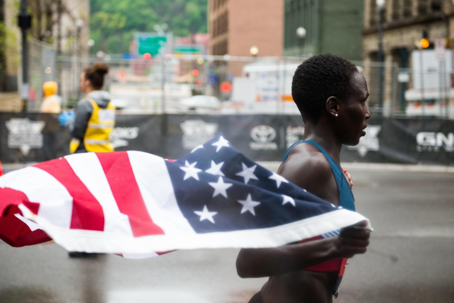 USA Track and Field Half Marathon Champion Aliphine Tuliamuk celebrates after holding first place for more than 11 miles. (Photo by Christian Snyder | Editor-in-Chief)