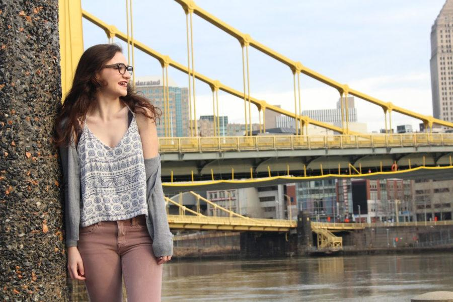 Sarah+Connor+enjoys+being+a+Pittsburgh+native+while+posing+on+the+North+Shore+in+front+of+iconic+Pittsburgh+bridges.+%28Photo+courtesy+of+Chloe+Yoder%29