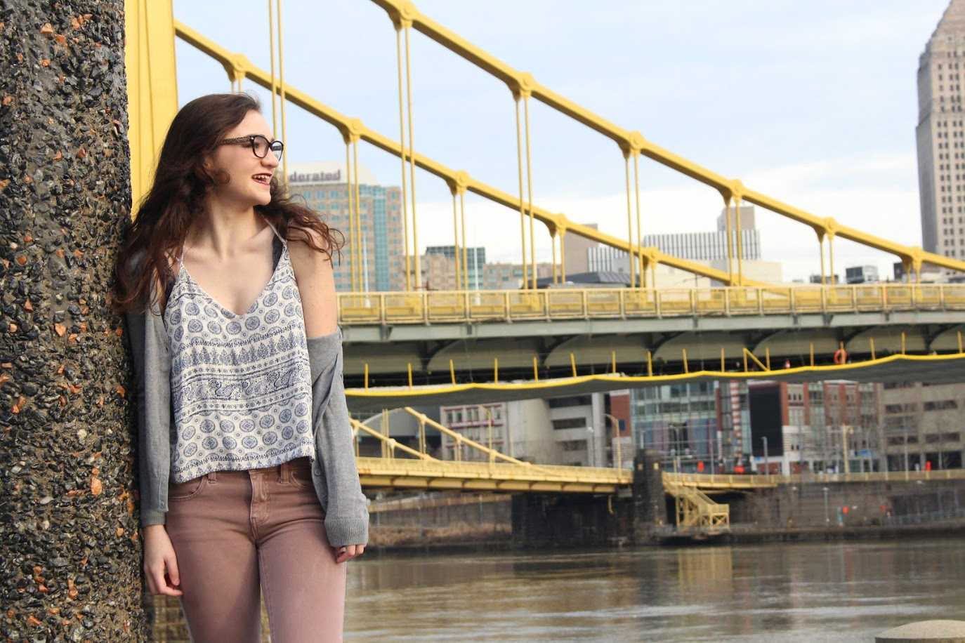 Sarah Connor enjoys being a Pittsburgh native while posing on the North Shore in front of iconic Pittsburgh bridges. (Photo courtesy of Chloe Yoder)