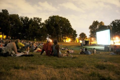 Locals enjoy watching a free movie in the park on Flagstaff Hill in Oakland. (The Pitt News File Photo)