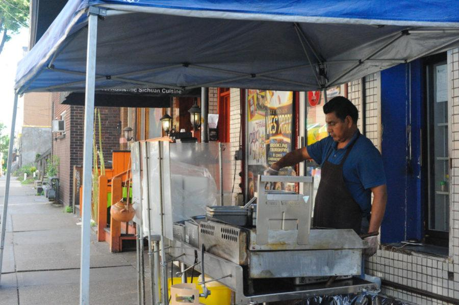 Las Palmas, a small Mexican grocery store tucked away on Atwood Street, offers traditional ingredients to its customers while tacos heat up on the grill outside of the store. (Photo by Anne Amundson | Staff Photographer)