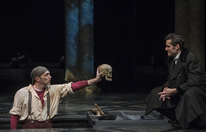 The Gravedigger, Tony Bingham, shows Hamlet, Matthew Amendt, Yorick's skull in Act V, Scene 1 of Pittsburgh Public Theater's production of Hamlet. (Photo courtesy of Michael Henninger)