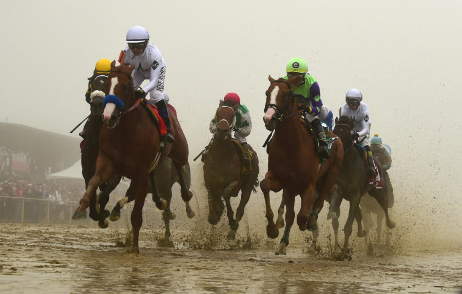 Justify+ridden+by+Mike+E.+Smith+won+the+143rd+Preakness+Stakes+Saturday%2C+May+19.+Despite+the+muddy+and+foggy+conditions+in+Baltimore%2C+Justify+claimed+the+second+leg+of+the+Triple+Crown.+%28Photo+courtesy+of+Kenneth+K.+Lam%2FBaltimore+Sun%2FTNS%29