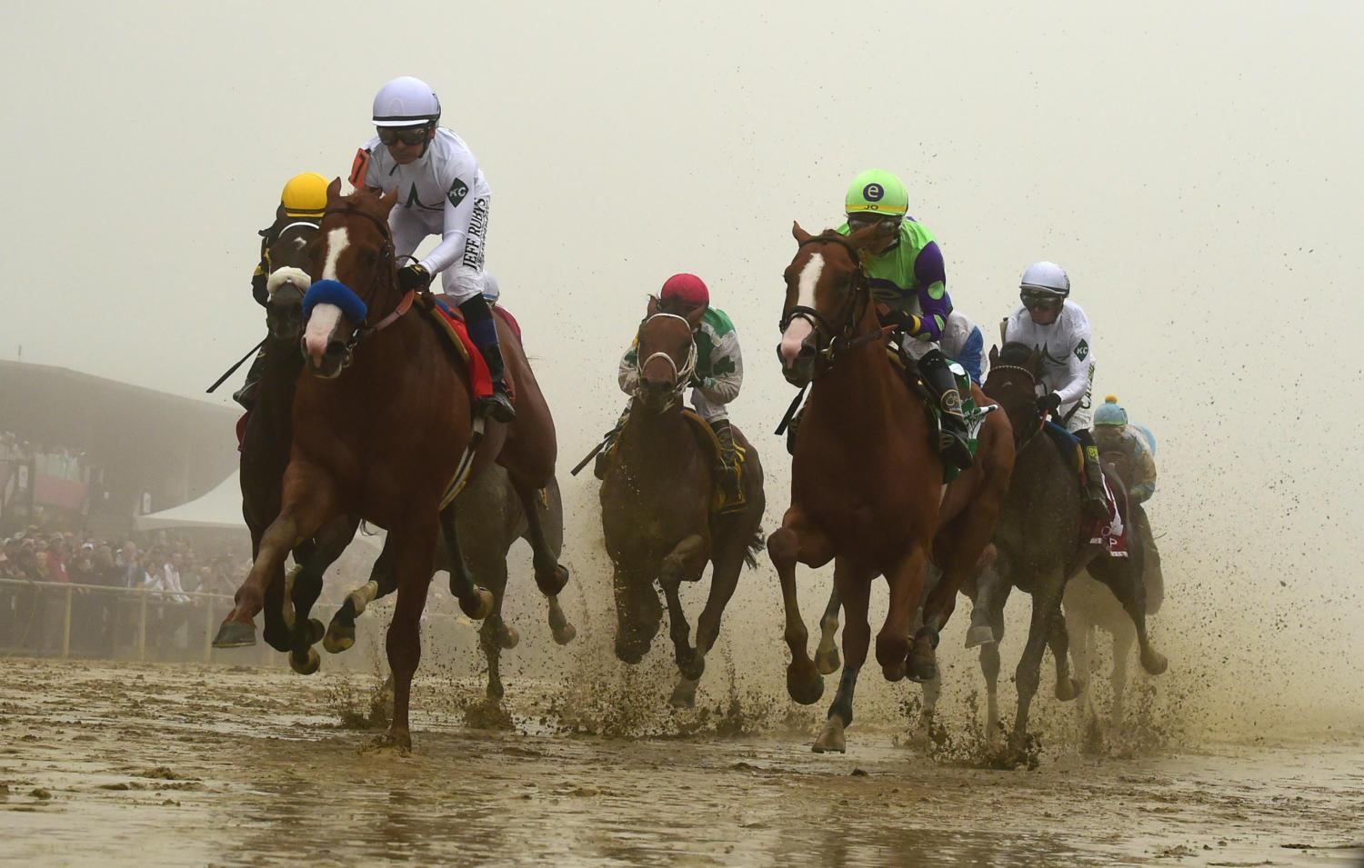 Justify ridden by Mike E. Smith won the 143rd Preakness Stakes Saturday, May 19. Despite the muddy and foggy conditions in Baltimore, Justify claimed the second leg of the Triple Crown. (Photo courtesy of Kenneth K. Lam/Baltimore Sun/TNS)