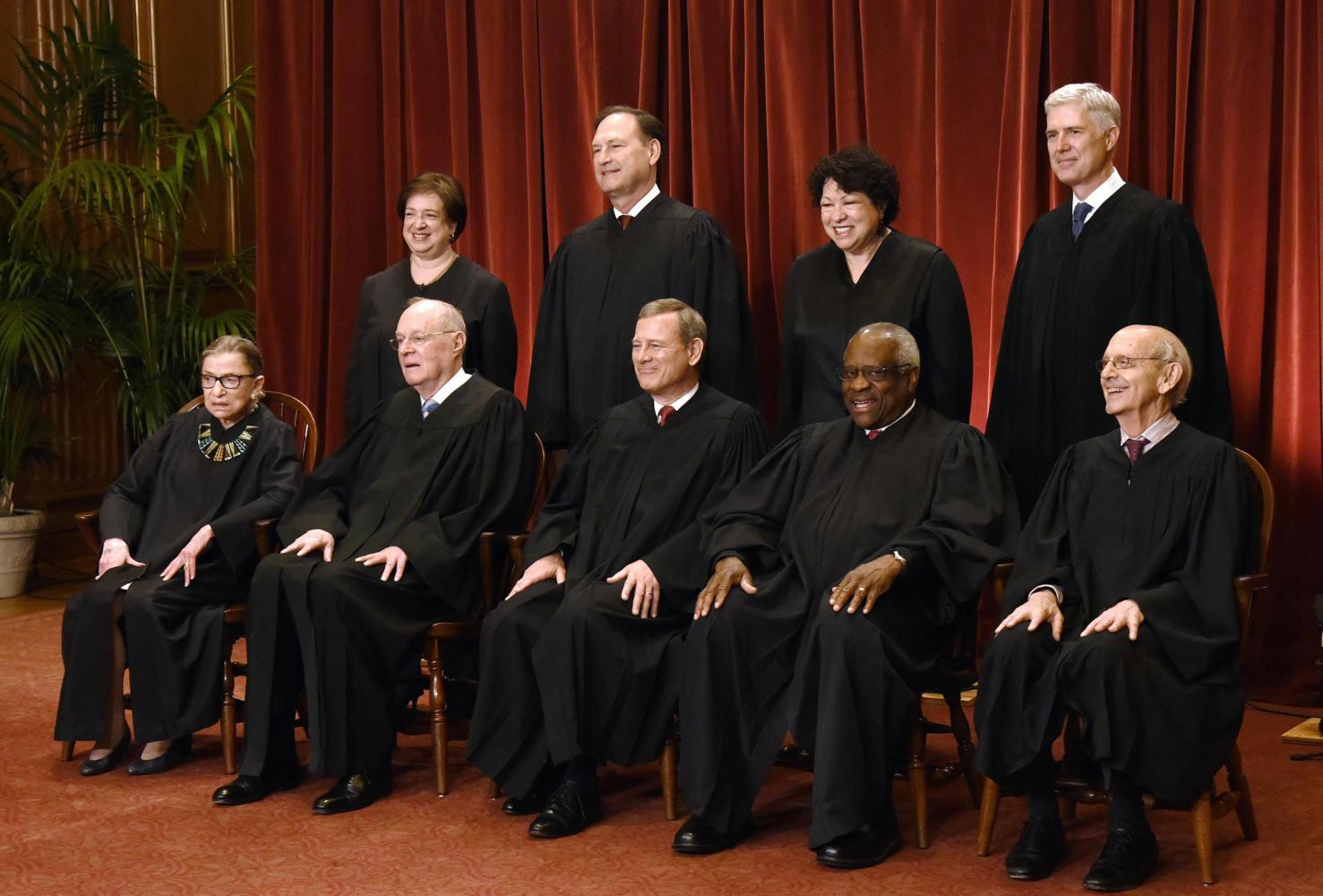 Members of the U.S. Supreme Court pose for a group photograph at the Supreme Court building on June 1, 2017, in Washington, D.C. Front row, seated from left, Associate Justice Ruth Bader Ginsburg, Associate Justice Anthony M. Kennedy, Chief Justice of the United States John G. Roberts, Associate Justice Clarence Thomas, and Associate Justice Stephen Breyer. Standing behind from left, Associate Justice Elena Kagan, Associate Justice Samuel Alito Jr., Associate Justice Sonia Sotomayor, and Associate Justice Neil Gorsuch. (Olivier Douliery/Abaca Press/TNS)