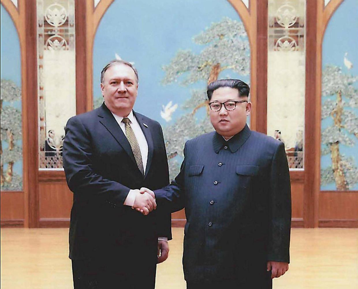 Photos released by the White House of then CIA Director Mike Pompeo, left, meeting North Korean leader Kim Jong Un in Pyongyang over Easter weekend. (White House/Zuma Press/TNS)