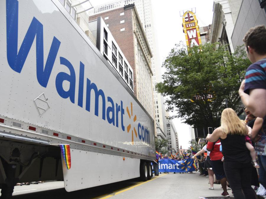 A+group+of+Walmart+employees+march+behind+a+company+truck+as+it+makes+its+way+through+EQT%E2%80%99s+pride+parade%2C+which+has+been+criticized+as+being+too+centered+around+corporations.+%28Photo+by+Anna+Bongardino+%7C+Visual+Editor%29