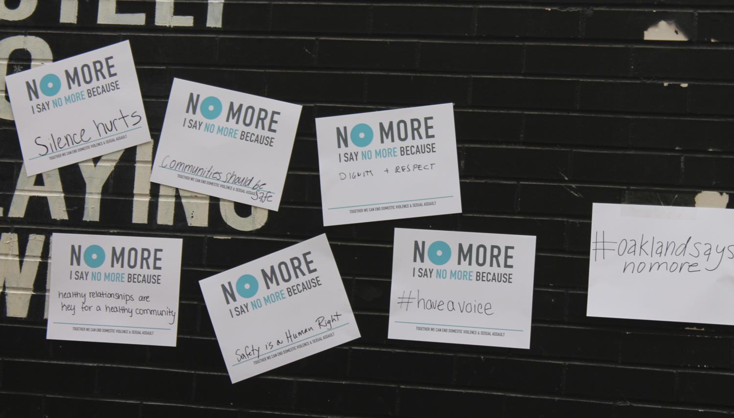 Oakland Says No More, a campaign which hopes to end workplace sexual harassment and violence, encouraged supporters to sign their petition at an event hosted on Oakland Avenue Tuesday evening. (Photo by Samuel Weber | Staff Writer)
