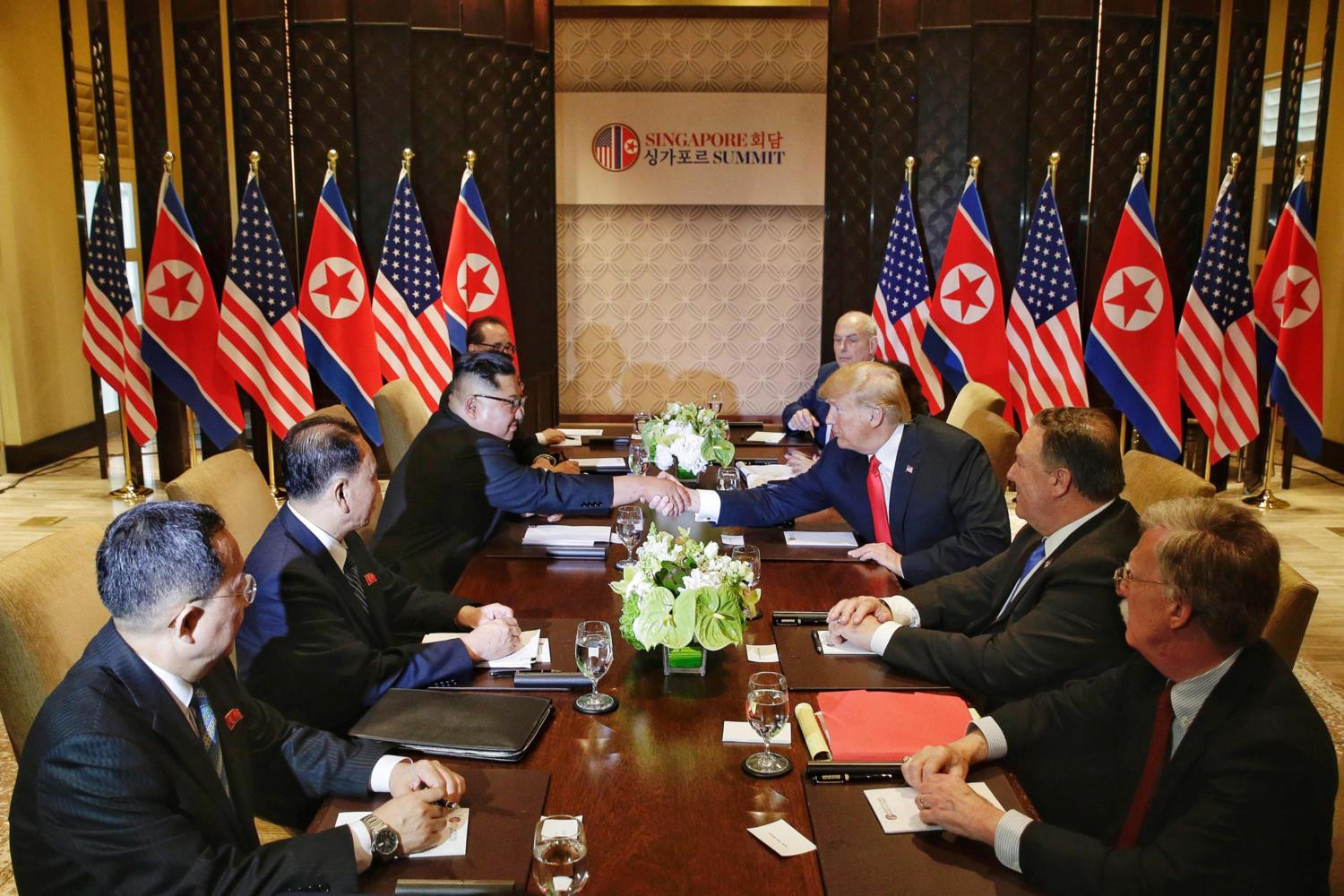 North Korea's Kim Jong Un, third from left, shakes hands with U.S. President Donald Trump, third from right, in Singapore Tuesday, June 12. (Kevin Lim/The Straits Times/Zuma Press/TNS)