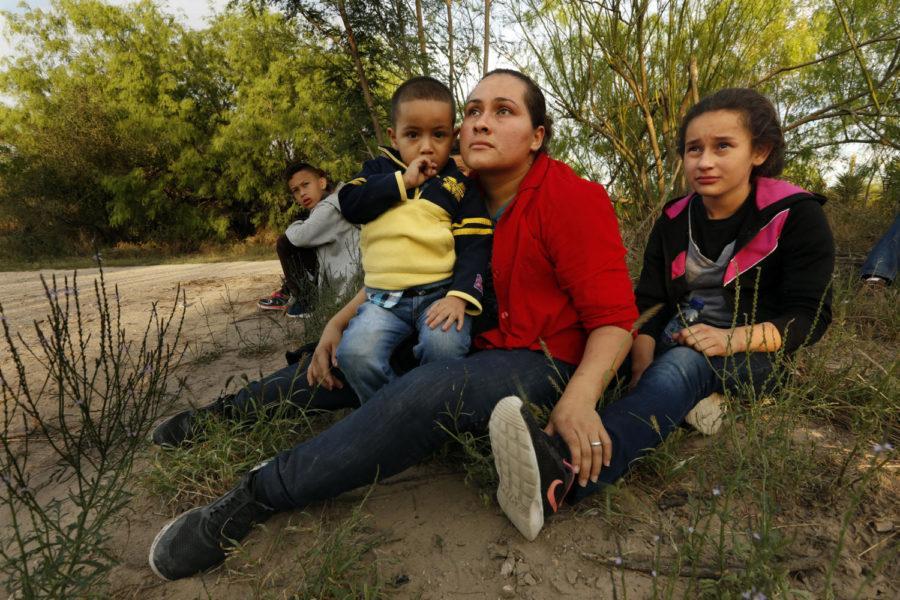 Hayti Alvarado, 26, holds her son Esteban Alvarado, 3, as her daughter Gabriella Alvarado, 11, cries in fear after being detained near the Rio Grande River. The Alvarado family had to flee their country after Gabriella was threatened at school. (Carolyn Cole/Los Angeles Times/TNS)