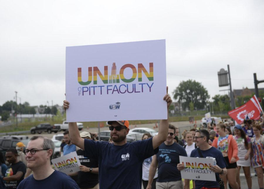 University+of+Pittsburgh+faculty+unionizers+make+an+appearance+at+the+People%E2%80%99s+Pride+parade+in+June+2018.+%28Photo+by+Jon+Kunitsky+%7C+Staff+Photographer%29